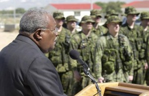 Unelected coup President Gerard Latortue speaks to Canadian soldiers.